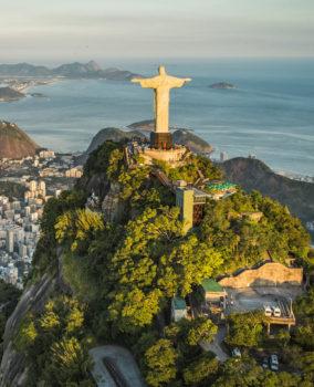RIO DE JANEIRO, BRAZIL - FEBRUARY 2016: Aerial view of Christ and Botafogo Bay from high angle.